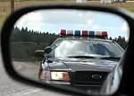 Amerikansk polisbil i backspegel